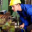 Stock Photo: Machinist operating industrial drilling press