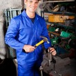 Blue collar worker working in workshop — Stock Photo #10229674