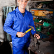 Blue collar worker working in workshop — Stock Photo