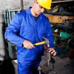 Industrial craftsman working in workshop — Stock Photo