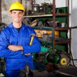 Stock Photo: Industrial repairman in workshop