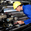 Printer running modern industrial printing machine — Stockfoto