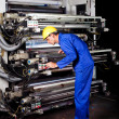 Printer operating industrial printing machine — Stock Photo