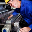 Happy industrial machine operator — Stock Photo