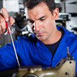 Mechanic repairing sewing machine — Stock Photo