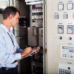 Technician writing down machine setting data — Stock Photo