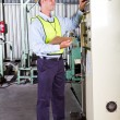 Industrial machine operator - Stock Photo