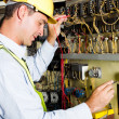 Electrician testing industrial machine — Stock Photo #10229892