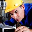 Metal worker using drillpress — Stock Photo