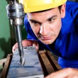 Factory worker using drilling machine — Stock Photo