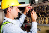 Electrician testing industrial machine — Stock Photo