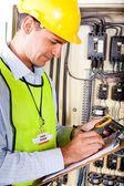 Technician recording machine temperature — Stock Photo