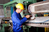 Industrial mechanic repairing machine — Stock Photo