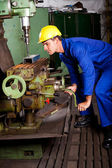 Machinist operating machine tool — Stock Photo
