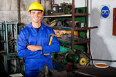 Industrial repairman in workshop — Stock Photo