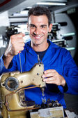 Happy industrial mechanic — Stock Photo
