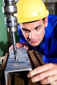Factory worker using drilling machine — Stock Photo