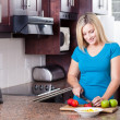 Young woman cooking in kitchen — Stock Photo #10235239