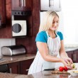 Young woman making fruit salad — Stock Photo #10235285