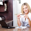 Stock Photo: Attractive young woman holding credit card