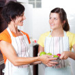 Stock Photo: Teen girl helping mother in kitchen