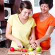 Mother teaching teen daughter cooking — Stock Photo