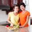 Mother and daughter making fruit salad — Stock Photo
