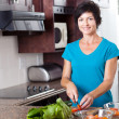 Stock Photo: Middle aged woman cooking