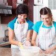 Happy mother and teen daughter baking — Stock Photo #10252751
