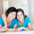 Middle aged mother and teen daughter on bed — Stock Photo #10252877