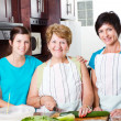 Grandmother cooking with her daughter and granddaughter — Stock Photo