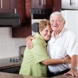 Elderly couple hugging at home — Stock Photo #10254056