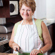 Happy senior woman cooking — Stock Photo