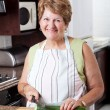 Royalty-Free Stock Photo: Happy senior woman cooking