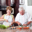 Elderly couple cooking — Stock Photo