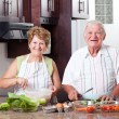 Senior couple cooking — Stock Photo #10254243