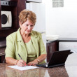 Senior woman doing home finance — Stock Photo
