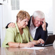 Senior couple worrying about money situation — Stock Photo