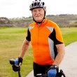 Senior male cyclist - Stock Photo
