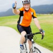 Senior bicyclist giving thumb up - Photo