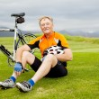 Senior bicyclist taking a break — Stock Photo