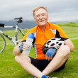 Stock Photo: Happy senior bicyclist resting
