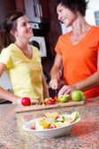 Happy mother and daughter cooking — Stockfoto