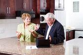 Elderly couple having argument — Stock Photo
