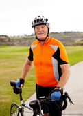 Senior male cyclist — Stock Photo