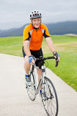 Active senior man riding bicycle — Stock Photo