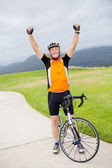 Cheerful senior man on bicycle — Stock Photo