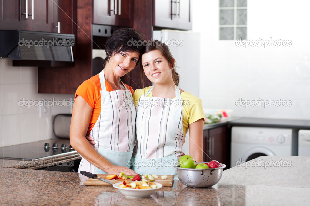 Mother And Daughter In Kitchen Stock Photo Michaeljung 10252312