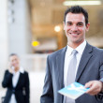 Businessman handing over air ticket — Stock Photo