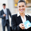 Stock Photo: Businesswomhanding over air ticket